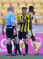Phoenix' Ben Sigmund protests a call by referee Strebre Delovski during the A-League football match between Wellington Phoenix v Central Coast Mariners at Westpac Stadium, Wellington, New Zealand on Sunday, 25 March 2012. Photo: Dave Lintott / lintottphoto.co.nz