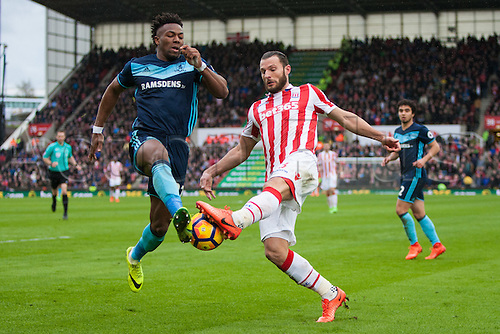 March 4th 2017,  bet365 Stadium, Stoke, England; EPL Premier League football, Stoke City versus Middlesbrough; Stoke's Erik Pieters and Middlesbrough's Adama Traore fight over a loose ball