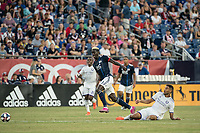 FOXBOROUGH, MA - JULY 27:  Wilfried Zahibo #23 escapes a tackle from Tesho Akindele #13 at Gillette Stadium on July 27, 2019 in Foxborough, Massachusetts.