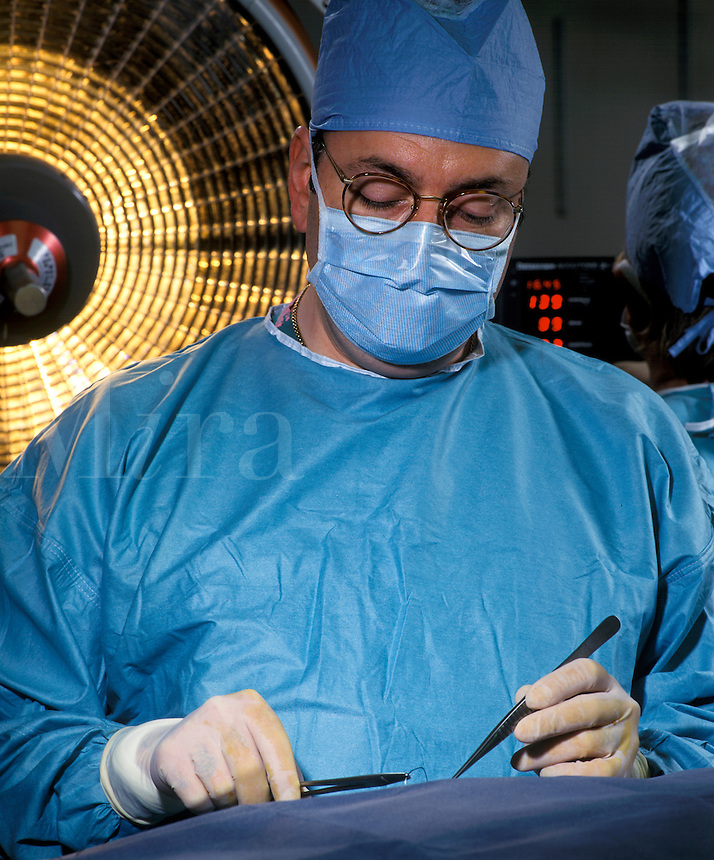 Surgeon performs an operation.