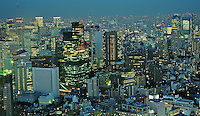The Tokyo skyline viewed from Roppongi district Tokyo, Japan. Tokyo is one of the most densely populated regions in the world, the massive metropolitan area is divided into 23 wards that make up the greater Tokyo downtown area. The Roppongi section of the city is the place provide one of the best views of the Tokyo skyline..14 Jan 2011