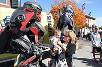 NWA Democrat-Gazette/DAVID GOTTSCHALK Lisa Oropallo and her grandson Brady Porter interact with Transformer characters Friday, November 2, 2018, during First Friday/Toyland in downtown Bentonville. Hosted by Downtown Bentonville Inc., the event featured Walmart venders bringing out toys and lifesize characters to give out toys, promotional items and to interact with visitors.
