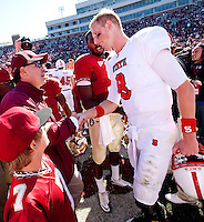 TALLAHASSEE, FL 10/29/11-FSU-NCST102911 CH-Florida State Head Coach Jimbo Fisher, left, is joined by his son Trey and EJ Manuel as they greet N.C. State quarterback Mike Glennon after the  Seminoles shut out the Wolfpack 34-0 Saturday at Doak Campbell Stadium in Tallahassee.COLIN HACKLEY PHOTO