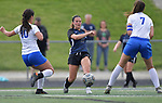Columbia's Reagan Mauch passes the ball between St. Teresa players Ryenne Wagner (left) and Rylie Danner (right) in the Class 1A girls soccer supersectional game played at Columbia High School in Columbia, IL on Tuesday May 21, 2019.<br /> Tim Vizer/Special to STLhighschoolsports.com