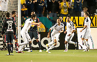 CARSON, CA – May 7, 2011: LA Galaxy midfielder Landon Donovan (10) celebrates his goal with teammate Omar Gonzalez (4), during the match between LA Galaxy and New York Red Bull at the Home Depot Center, May 7, 2011 in Carson, California. Final score LA Galaxy 1, New York Red Bull 1.