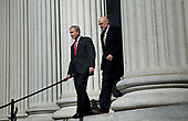 Washington, D.C. - October 3, 2008 -- United States President George W. Bush (L) and Secretary of the Treasury Henry M. Paulson Jr. leave the Treasury, Friday, October 3, 2008 in Washington, DC.  The U.S. House of Representatives voted earlier in the day to approve a revised version of Wall Street bail out legislation.<br /> Credit: Brendan Smialowski - Pool via CNP