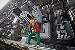 © Joel Goodman - 07973 332324 . 7 December 2013 .  Justin Blackhurst (31 from Stockport) (correct) dressed as an elf - makes his descent having passed his elf and safety check . In scenes reminiscent of a Fathers for Justice demonstration , people in superhero and Christmas-themed costumes , abseil 107 metres down the New York Street side of City Tower to raise money for the Factory Youth Zone in Harpurhey . Photo credit : Joel Goodman