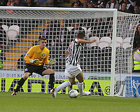 Kenny McLean slots the ball past Ally Brown for the opening goal in the St Mirren v Ayr United Scottish Communities League Cup match played at St Mirren Park, Paisley on 29.8.12.