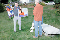 James Sowles, of Boston, Mass., (left) shows off home-made campaign signs before Democratic presidential candidate and Hawaii representative (D-HI 2nd) Tulsi Gabbard arrives to speak at a campaign event at Weare Public Library in Weare, New Hampshire, on Thu., September 5, 2019.