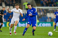 Sean Morrison of Cardiff City passes back to goal under pressure from Kalvin Phillips of Leeds United during the Sky Bet Championship match between Cardiff City and Leeds United at the Cardiff City Stadium, Cardiff, Wales on 26 September 2017. Photo by Mark  Hawkins / PRiME Media Images.