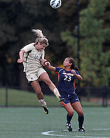 Boston College midfielder Gibby Wagner (10) heads the ball. Pepperdine University midfielder/defender Micaela Cervantes (23). Pepperdine University defeated Boston College,1-0, at Soldiers Field Soccer Stadium, on September 29, 2012.