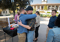 "Woody Studenmund, Laurence de Rycke Professor of Economics, hugs Tyler Melchisky '21.<br /> The Occidental College Veterans Program hosts ""Hug-A-Vet"" in the Academic Quad on Nov. 11, 2019, Veterans Day. Students could stop by for snacks, hugs, high fives and conversation with Oxy veterans, who shared information about Oxy's military history and answered questions about their paths to college.<br /> (Photo by Marc Campos, Occidental College Photographer)"