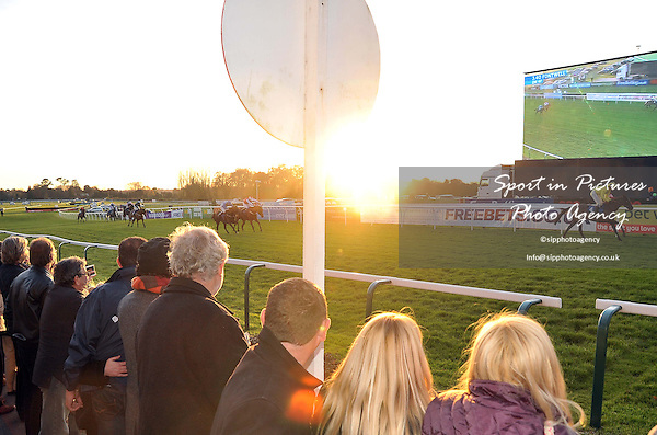 The last race in the setting sun. Race 7. hardingscatering.co.uk Maiden Hurdle. Food & Drink Southern National Raceday. Fontwell Park Racecourse. West Sussex. 18/11/2012. MANDATORY Credit Garry Bowden/Sportinpictures - NO UNAUTHORISED USE - 07837 394578