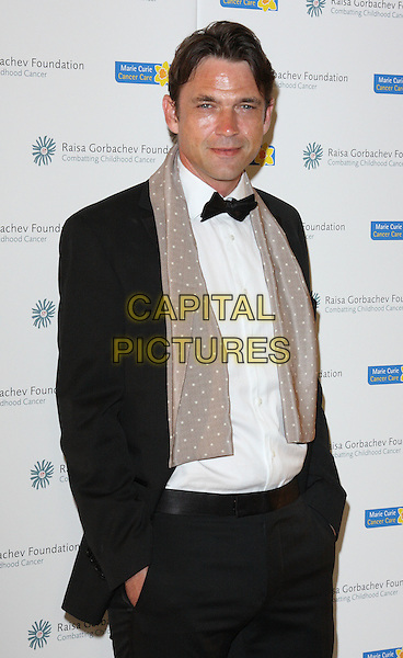 DOUGRAY SCOTT .The Raisa Gorbachev Foundation Gala at Stud House, Hampton Court, London, England, UK, June 5th 2010.half length hands in pockets polka dot grey gray scarf black suit tuxedo tux bow tie white shirt.CAP/ROS.©Steve Ross/Capital Pictures