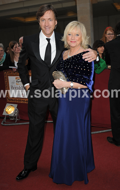 "**ALL ROUND PICTURES FROM SOLARPIX.COM**.**WORLDWIDE SYNDICATION RIGHTS**.Authors and celebrities arrive for the Galaxy British Book Awards or ""Nibbies"" at the Grosvenor House Hotel in London..This pic:  Richard Madely & Judy Finnegan.JOB REF:  8765    SSD     DATE:  04.04.09.**MUST CREDIT SOLARPIX.COM OR DOUBLE FEE WILL BE CHARGED**.**ONLINE USAGE FEE GBP 50.00 PER PICTURE - NOTIFICATION OF USAGE TO PHOTO @ SOLARPIX.COM**.**CALL SOLARPIX : +34 952 811 768 or LOW RATE FROM UK 0844 617 7637**"