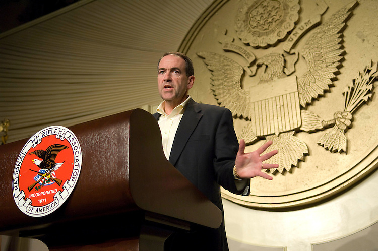 "WASHINGTON, DC - Sept. 21: Former GOP Arkansas Gov. Mike Huckabee speaks at a National Rifle Association meeting, ""A Celebration of American Values,"" at the Capitol Hilton in Washington. Top Republican presidential candidates courted the powerful National Rifle Association on Friday, with former New York City Mayor Rudolph Giuliani trying hard to convince the group that he would support Second Amendment rights for gun owners. The NRA is a key constituency especially for GOP candidates seeking their party's nomination. The lobbying group has nearly 3 million members and a political action committee that raised more than $10 million for every election cycle since the 2000 presidential election, and has shown its ability to mobilize its constituency. Meeting in Washington Friday, NRA members received appeals from top GOP presidential candidates Sen. John McCain, Giuliani, former Tennessee Sen. Fred Thompson and former Arkansas Gov. Mike Huckabee. Former Massachusetts Gov. Mitt Romney and Rep. Duncan Hunter, D-Calif., provided videotaped addresses, while New Mexico Gov. Bill Richardson was the sole Democratic presidential candidate to address the association Friday, albeit in a videotaped speech. Each candidate sought to emphasize their credentials on guns and Second Amendment issues, but Giuliani faced the challenge of dealing with his past record, having been a strong advocate of gun control while New York's mayor and suggesting in a television interview that the NRA were ""extremists."" (Photo by Scott J. Ferrell/Congressional Quarterly)."
