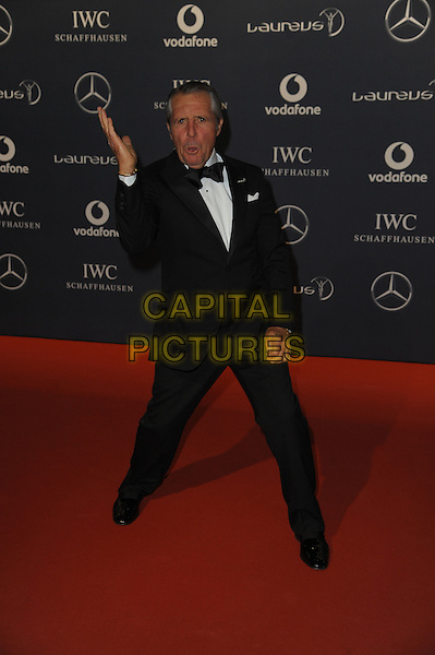 Gary Player.Arrivals at the Laureus 2012 World Sports Awards held at the Queen Elizabeth II Centre, London, England..February 6th, 2012.full length black tuxedo hands karate gesture funny arms hands.CAP/CAS.©Bob Cass/Capital Pictures.