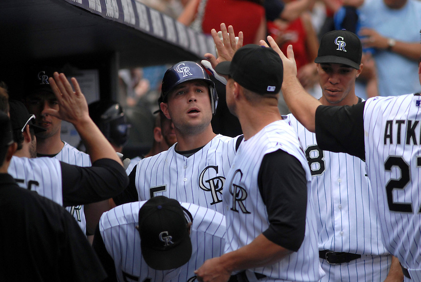 14 August 08: Colorado Rockies outfielder Matt Holliday celebrates hitting a solo homerun with teamates. The Arizona Diamondbacks defeated the Colorado Rockies 6-2 at Coors Field in Denver, Colorado.