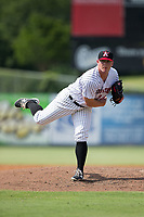 Kannapolis Intimidators relief pitcher Matt Foster (24) follows through on his delivery against the Hagerstown Suns at Kannapolis Intimidators Stadium on July 9, 2017 in Kannapolis, North Carolina.  The Intimidators defeated the Suns 3-2 in game one of a double-header.  (Brian Westerholt/Four Seam Images)