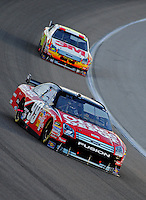 Nov. 16, 2008; Homestead, FL, USA; NASCAR Sprint Cup Series driver Carl Edwards (99) leads teammate Greg Biffle during the Ford 400 at Homestead Miami Speedway. Mandatory Credit: Mark J. Rebilas-