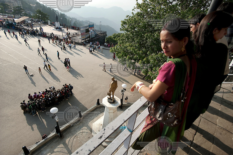 People look down onto the Mall. The city is in the foothills of the Himalayas, and sits at an elevation of 2,000 metres. It was the summer capital of the British Raj and remains today a popular hill station resort for domestic and foreign visitors.