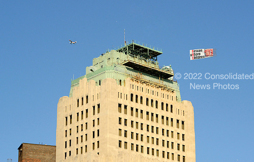 A pro-life banner is towed behind an airplane over a building near the Quicken Loans Arena, the site of the 2016 Republican National Convention in Cleveland, Ohio on Friday, July 15, 2016.<br /> Credit: Ron Sachs / CNP<br /> (RESTRICTION: NO New York or New Jersey Newspapers or newspapers within a 75 mile radius of New York City)