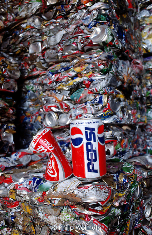 Crushed Pepsi and Coca Cola cans in a Haringey Council recycling centre, London.