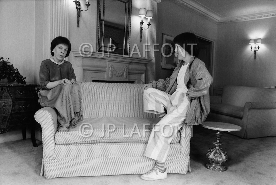 "Manhattan, New York - May 5, 1983. The everyday citizen Linda Hunt sits on the right of the sofa, contemplating the public persona of actress Linda Hunt on the left. She is one of the actresses who received the most attention at the 1983 Cannes Film Festival and was the co-star (with Mel Gibson) in Peter Weir's movie, ""The Year of Living Dangerously"". Hunt (born April 2, 1945) is an American actress best known for her role as Henrietta Lange in the CBS series NCIS: Los Angeles. *This is a unique image, taken with a filter, without Photoshop montage."