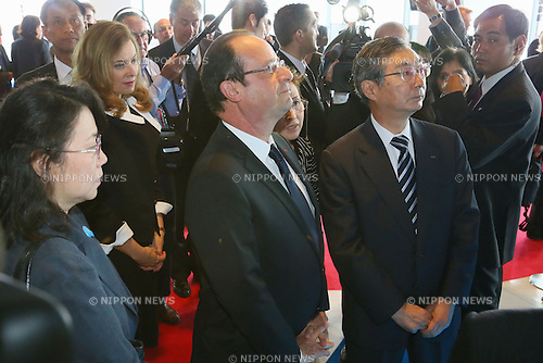 """June 7, 2013, Tokyo, Japan - France's President Francois Hollande, his companion Valerie Trierweiler are escorted by Tadashi Onodera, KDDI Corporation Chairman, during """"Innovons ensemble"""", at Shibuya Hikarie in Tokyo, Japan, June 7, 2013.  President Hollande is in Japan for a three-day state visit. (Photo by Yusuke Nakanishi/Pool/Abaca Presse)"""