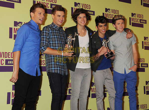 One Direction - Louis Tomlinson, Liam Payne, Harry Styles, Zayn Malik, Niall Horan.poses in the press room during the 2012 MTV Video Music Awards at Staples Center in Los Angeles, California, USA, September 6th 2012..press room pressroom vmas vma half length band group 1d one blue shirt plaid grey gray award trousers jeans .CAP/ROT/TM.©TM/Roth Stock/Capital Pictures