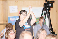 People listen as Vermont senator and Democratic presidential candidate Bernie Sanders speaks at a campaign event at the White Mountain Chalet event hall in Berlin, New Hampshire.