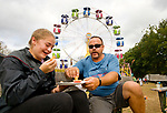 RIVERTON , CT-101517JS03-- Lexie Dings, 12, of New Hartford,  and her father Fran Dings, enjoy some fried dough sticks as they take a break during the final day of the 108th Riverton Fair on Sunday. <br /> Jim Shannon Republican-American