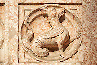 Medieval relief sculptures of mythical dragon on the exterior of the Romanesque Baptistery of Parma, circa 1196, (Battistero di Parma), Italy