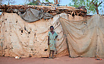A girl stands in front of her family's shelter in the Yida refugee camp in South Sudan. Some 53,000 refugees from Sudan's Nuba Mountains live in the camp, with an equal number living in two nearby camps.