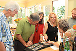 Robert Jacobi and friends looking at album