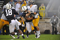 21 September 2013:  Penn State DT DaQuan Jones (91) hits Kent State QB Colin Reardon (10). The Penn State Nittany Lions defeated the Kent State Golden Flashes 34-0 at Beaver Stadium in State College, PA.