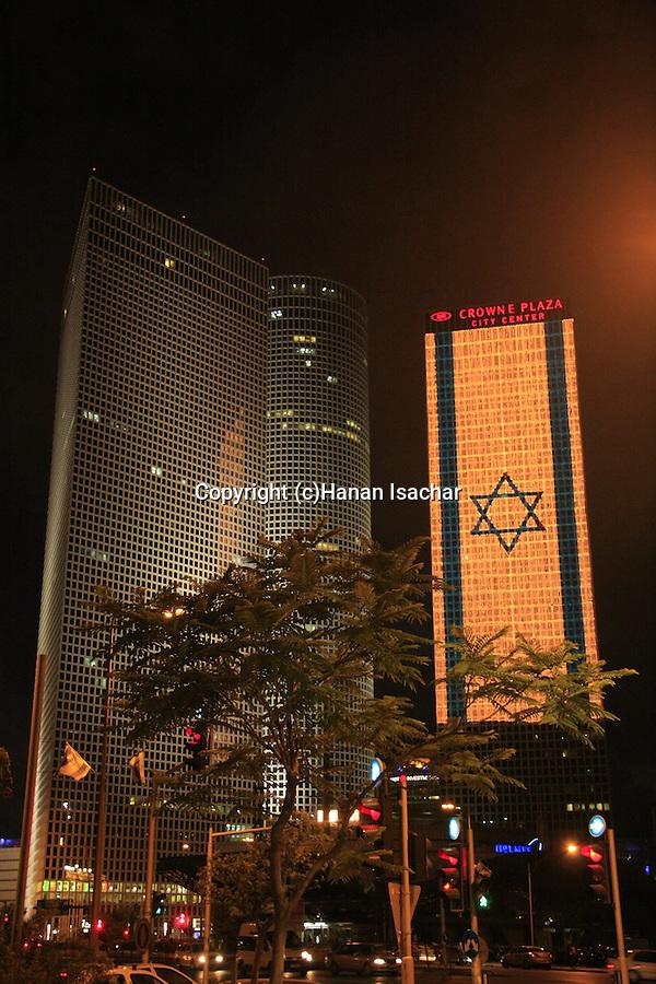 Israel, Tel Aviv, an illuminated Israeli flag at Azrieli Center on Independence day