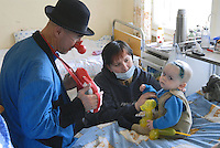 "- 20 years from the nuclear incident of Chernobyl, pediatric oncologic hospital of Kiev, volunteers of Italian humanitarian association  ""Veronica Sacchi"" play with the sick children  victims of the radiations....- 20 anni dall'incidente nucleare di Chernobyl, ospedale oncologico pediatrico di Kiev, volontari dell'associazione umanitaria italiana ""Veronica Sacchi"" giocano coi bambini ammalati vittime delle radiazioni"