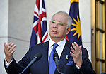 Malaysian Prime Minister Mohd Najib bin Tun Abdul Razak gestures during a press conference with Australian Prime Minister Julia Gillard at Parliament House Canberra, Thursday, March 3, 2011. The Malaysian Prime Minister is on a three day visit to Australia. (AP Photo/Mark Graham)