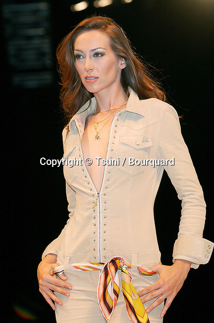 """model wearing J.Lo Collection  walking the runway at the """" Light as a Feather Fashion Show """" witch will raise money to benefit CAAF - Children Affected by AIDS Foundation. The fashion Show was at the Convention Center in Los Angeles. June 21, 2002.           -            JLo_collection58.jpg"""