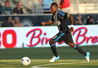CHESTER, PA - AUGUST 12, 2012:  Freddy Adu (11) of the Philadelphia Union goes forward against the Chicago Fire during an MLS match at PPL Park, in Chester, PA on August 12. Fire won 3-1.