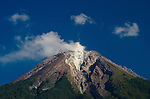 The volcano Mount Ebulobo steams against a blue sky, near Boawae, central Flores, Indonesia