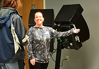 NWA Democrat-Gazette/FLIP PUTTHOFF <br />Poll worker Kitrina Napier (cq) shows voters on Tuesday Dec. 4 2018 to voting machines at Bentonville Church of Christ in the Bentonville mayoral election.