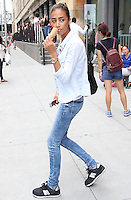 NEW YORK, NY - JULY 29:   A woman enjoy a free ice  cream cone  from the Museum of Ice Cream pop up shop in The Meatpacking District on opening day where patrons were offered free treats from 11am-3pm  in New York, New York on July 29, 2016.  Photo Credit: Rainmaker Photo/MediaPunch