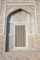 "Agra, India.   Geometric Window Design, with Pietra Dura Stone Work.  Itimad-ud-Dawlah, Mausoleum of Mirza Ghiyas Beg.  The tomb is sometimes referred to as the ""Baby Taj.""  It is one of the finest examples of pietra dura work, making designs through the use of inlaid colored stone."