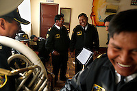 The Bolivian Navy band jokes at the Tiquina Naval Base on Lake Titicaca. Bolivia lost what is now northern Chile in a war over nitrates leaving Bolivia without access to the ocean.