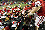 Wisconsin Badgers captains pass the Leaders Division Trophy to their teammates after an NCAA Big Ten Conference college football game against the Penn State Nittany Lions on November 26, 2011 in Madison, Wisconsin. The Badgers won 45-7. (Photo by David Stluka)
