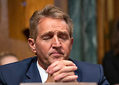 United States Senator Jeff Flake (Republican of Arizona) listens to the opening statements as the US Senate Committee on the Judiciary meets to vote on the nomination of Judge Brett Kavanaugh to be Associate Justice of the US Supreme Court to replace the retiring Justice Anthony Kennedy on Capitol Hill in Washington, DC on Friday, September 28, 2018.  If the committee votes in favor of Judge Kavanaugh then it goes to the full US Senate for a final vote.<br /> Credit: Ron Sachs / CNP<br /> (RESTRICTION: NO New York or New Jersey Newspapers or newspapers within a 75 mile radius of New York City)