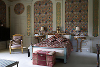 Inside the house on the Clandeboye estate, which is the home to Lady Dufferin, Marchioness of Dufferin and Ava. A guest bedroom in the house is richly decorated with pattern, colour and gilded furniture.