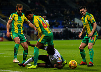 Bolton Wanderers' Clayton Donaldson battles with West Bromwich Albion's Craig Dawson and Mason Holgate<br /> <br /> Photographer Alex Dodd/CameraSport<br /> <br /> The EFL Sky Bet Championship - Bolton Wanderers v West Bromwich Albion - Monday 21st January 2019 - University of Bolton Stadium - Bolton<br /> <br /> World Copyright © 2019 CameraSport. All rights reserved. 43 Linden Ave. Countesthorpe. Leicester. England. LE8 5PG - Tel: +44 (0) 116 277 4147 - admin@camerasport.com - www.camerasport.com